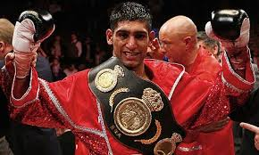 Amir Khan impressively beat Devon Alexander to defend his WBC Silver Welterweight title.