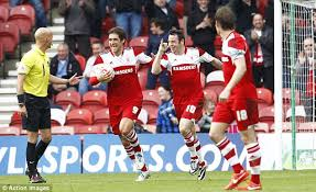 A Lee Tomlin brace helped Middlesborough see of Huddersfield.