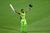 Pakistan's Sarfraz Ahmed raise his bat aloft after helping Pakistan to a seven wicket win. over Ireland. The win against Ireland means they will now play hosts Australia in the quarter final.