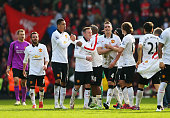 Manchester United's players celebrate their 2-1 win over Liverpool at Anfield.