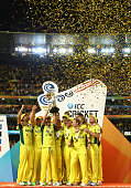 Australia's players hold the trophy aloft as they celebrate their fiffth world cup success.